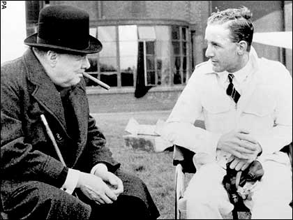 Alex Henshaw chatting with prime minister Winston Churchill about the Spitfire